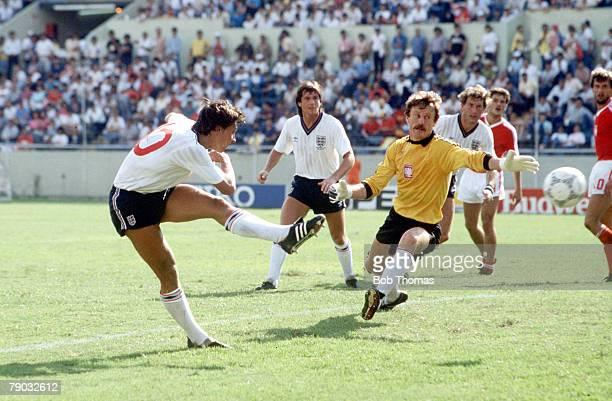 World Cup Finals Monterrey Mexico 11th June England 3 v Poland 0 England's Gary Lineker shoots past Polish goalkeeper Jozef Mlynarczyk scoring his...