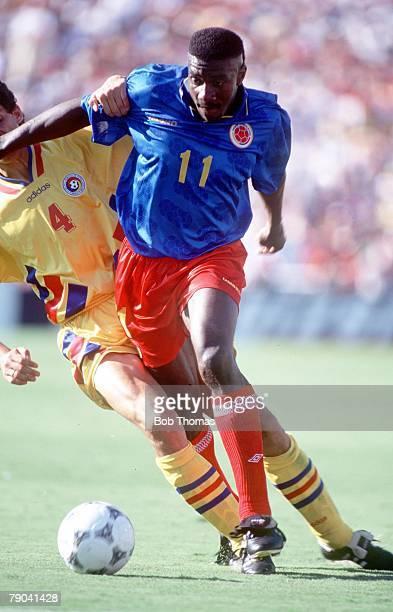 World Cup Finals Pasadena USA 18th June Romania 3 v Colombia 1 Colombia's Adolfo Valencia with Romania's Belodedici