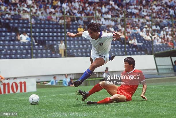 World Cup Finals Puebla Mexico 10th June Italy 3 v South Korea 2 Italy's De Napoli hurdles the challenge of South Korea's Kun Bum Cha