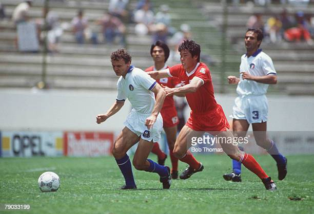 World Cup Finals Puebla Mexico 10th June Italy 3 v South Korea 2 Italy's Pietro Vierchowod is challenged for the ball by South Korea's Bum Kun Cha