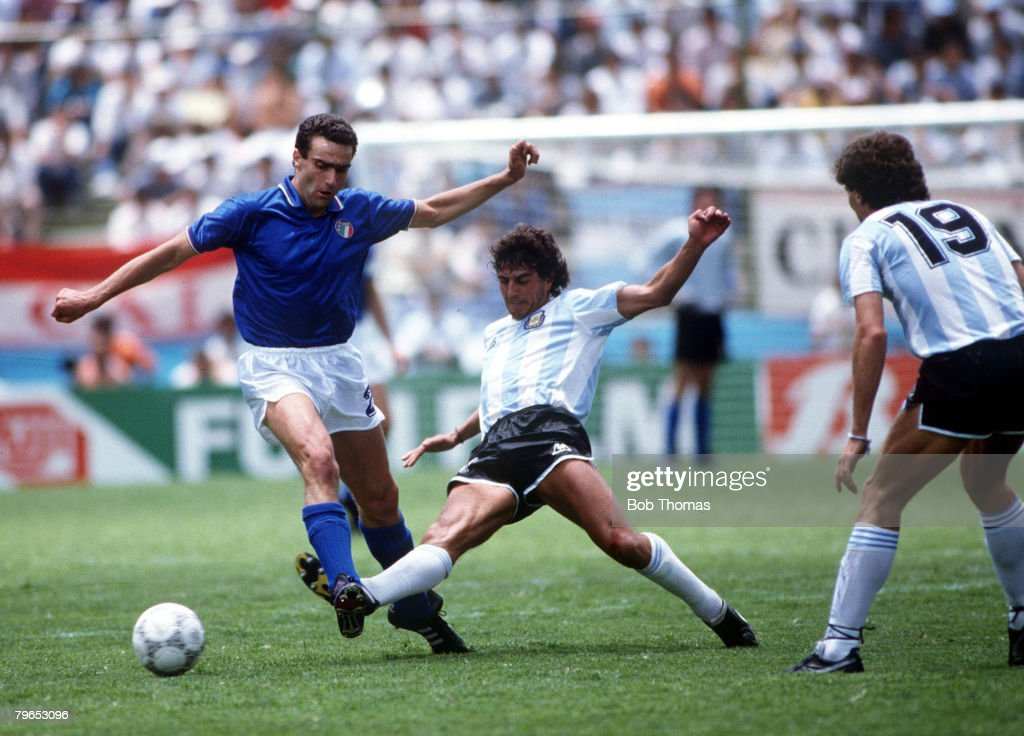 World Cup Finals, Puebla, Mexico, 5th June, 1986, Italy 1 v Argentina 1, Italy's Giuseppe Bergomi is tackled by Argentina's Ricardo Giusti