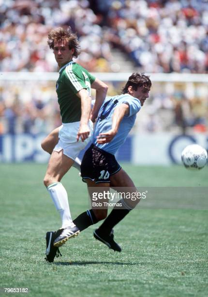 World Cup Finals Queretaro Mexico 4th June 1986 West Germany 1 v Uruguay 1 West Germany's Eder battles for the ball with Uruguay's Enzo Francescoli