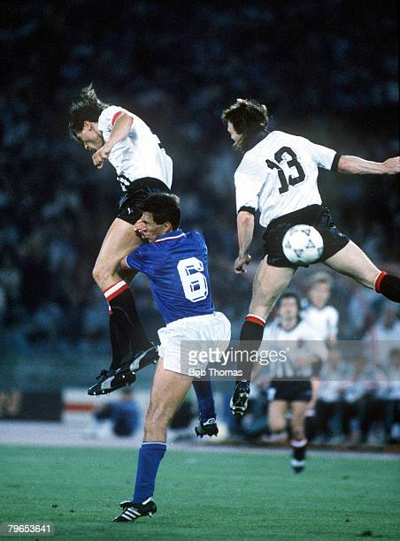 World Cup Finals Rome Italy 9th June Italy 1 v Austria 0 Italy's Riccardo Ferri is beaten to the ball in the air by Austria's Anton Polster and...