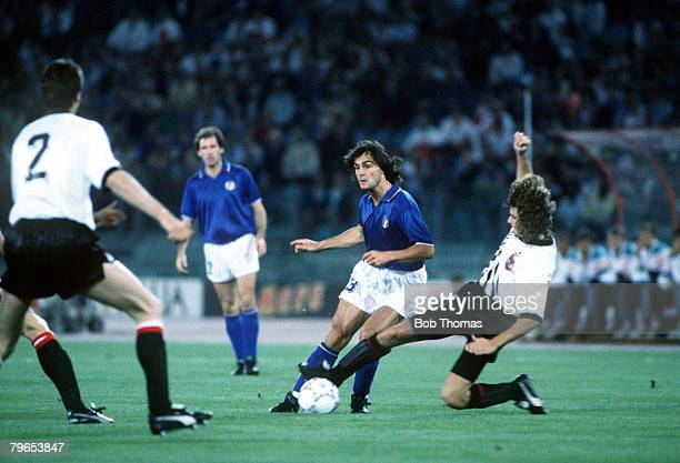 World Cup Finals Rome Italy 9th June Italy 1 v Austria 0 Italy's Giuseppe Giannini is challenged by an Austrian defender