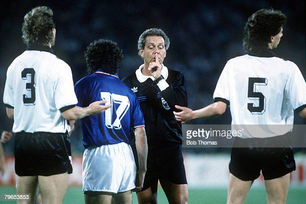 World Cup Finals Rome Italy 9th June Italy 1 v Austria 0 Referee Jose Ramiz Wright of Brazil calms down players from both teams as tension rises