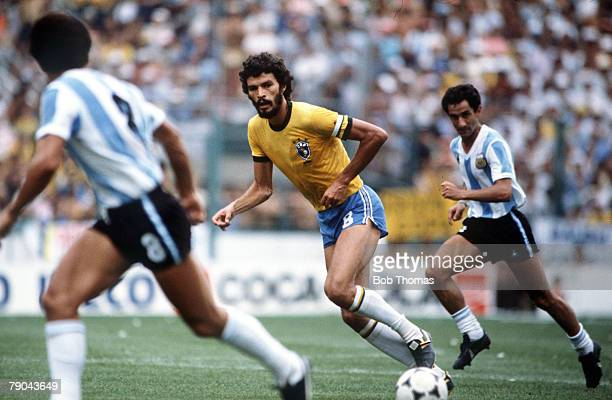 World Cup Finals Second Phase Barcelona Spain 2nd July Brazil 3 v Argentina 1 Brazil's Socrates watched by two Argentine players