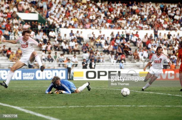 World Cup Finals Second Phase Leon Mexico 15th June Belgium 4 v USSR 3 Belgium's goalkeeper Jean Marie Pfaff in difficulties as USSR's Sergei...