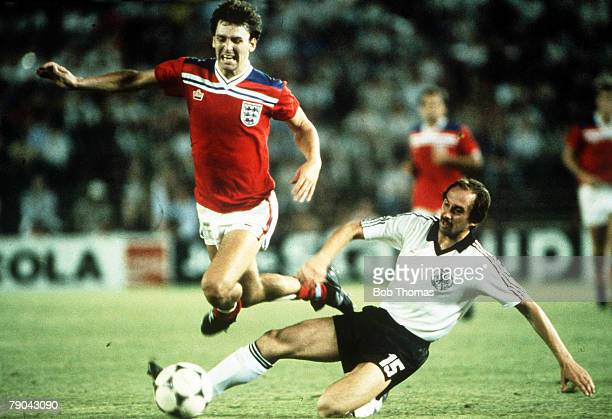 World Cup Finals Second Phase Madrid Spain 29th June England 0 v West Germany 0 England's Bryan Robson leaps over a tackle by West Germany's Uli...