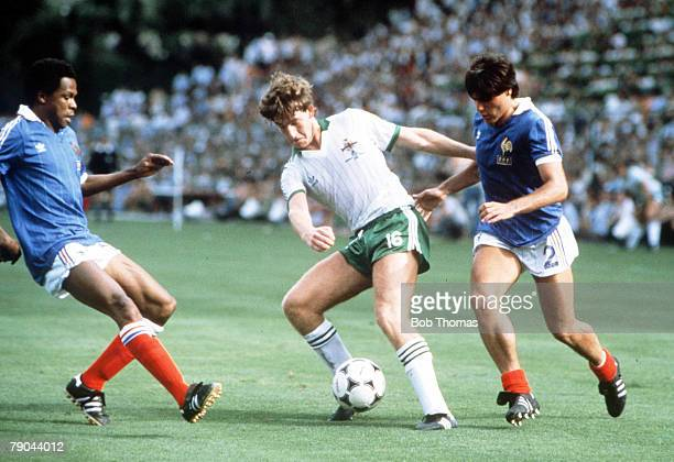 World Cup Finals Second Phase Madrid Spain 4th July France 4 v Northern Ireland 1 Northern Ireland's Norman Whiteside holds off France's Alain...