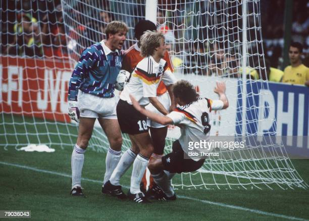 World Cup Finals Second Phase Milan Italy 24th June West Germany 2 v Holland 1 West Germany's Rudi Voeller clashes with Holland's Frank Rijkaard and...
