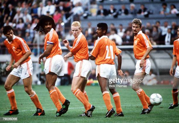 World Cup Finals Second Phase Milan Italy 24th June West Germany 2 v Holland 1 The Dutch defensive wall watch the ball fly by from a West German free...