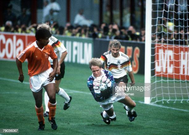 World Cup Finals Second Phase Milan Italy 24th June West Germany 2 v Holland 1 Dutch goalkeeper Hans Van Breukelen hangs on to the ball under...