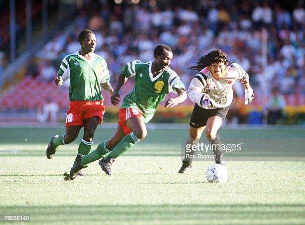 World Cup Finals Second Phase Naples Italy 23rd June Cameroon 2 v Colombia 1 Cameroon's Roger Milla dispossesses Colombian goalkeeper Rene Higuita of...
