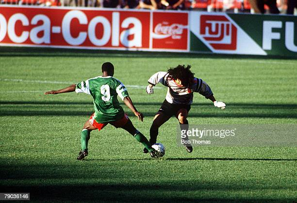 World Cup Finals Second Phase Naples Italy 23rd June Cameroon 2 v Colombia 1 Cameroon's Roger Milla tackles eccentric Colombian goalkeeper Rene...