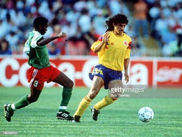 World Cup Finals Second Phase Naples Italy 23rd June Cameroon 2 v Colombia 1 Colombia's Leonel Alvarez is challenged for the ball by Cameroon's Mbouh...