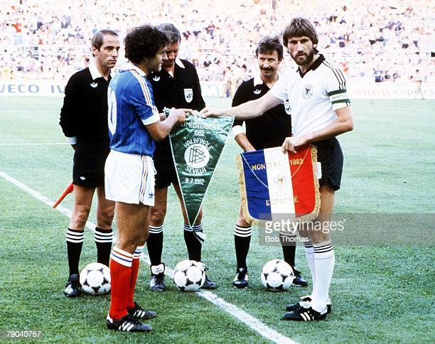 World Cup Finals SemiFinal Seville Spain 8th July West Germany 3 v France 3 West Germany captain Manny Kaltz exchanges pennants with French captain...
