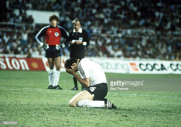 World Cup Finals SemiFinal Seville Spain 8th July West Germany 3 v France 3 West Germany's Uli Stielike is dejected as he buries his head after he...