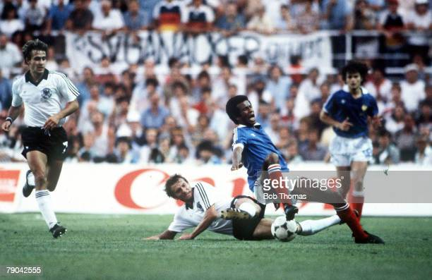 World Cup Finals SemiFinal Seville Spain 8th July West Germany 3 v France 3 France's Jean Tigana is tackled by West Germany's Wolfgang Dremmler as...