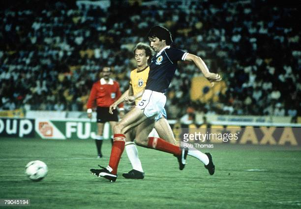 World Cup Finals Seville Spain 18th June Brazil 4 v Scotland 1 Scotland's Alan Hansen outpaces Brazil's Paulo Falcao