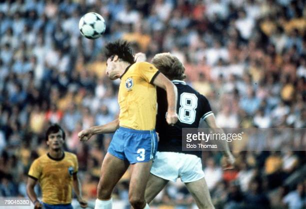 World Cup Finals Seville Spain 18th June Brazil 4 v Scotland 1 Brazil's Oscar outjumps Scotland's Steve Archibald to head the ball