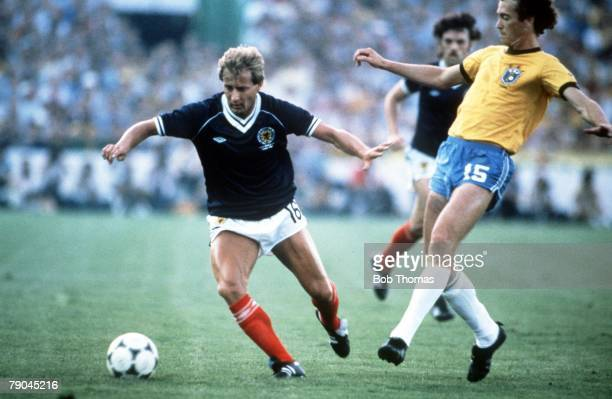 World Cup Finals Seville Spain 18th June Brazil 4 v Scotland 1 Brazil's Paulo Falcao moves in to challenge Scotland's Asa Hartford