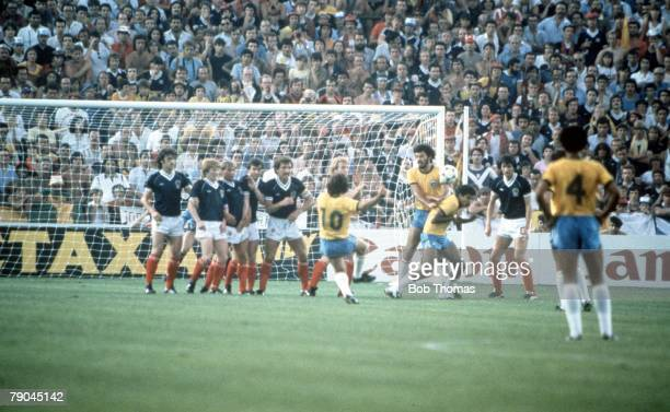 World Cup Finals Seville Spain 18th June Brazil 4 v Scotland 1 Brazil's Zico bends the ball around the Scottish wall to score their first goal from a...