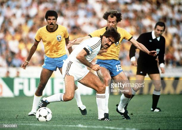 World Cup Finals Seville Spain 23rd June Brazil 4 v New Zealand 0 New Zealand's Steve Sumner is challenged by Brazil's Paulo Falcao as teammate...
