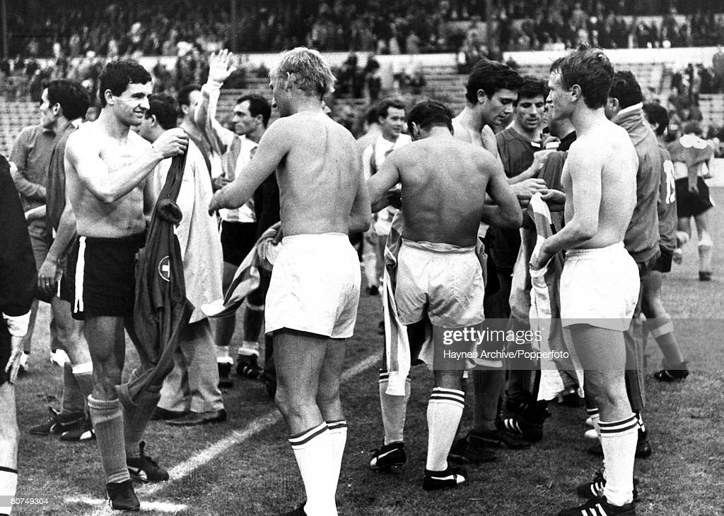 World Cup Finals Sheffield England 19th July Argentina 2 v Switzerland 0 Roberto Perfumo of Argentina exchanges shirts with Heinz Bani of Switzerland...