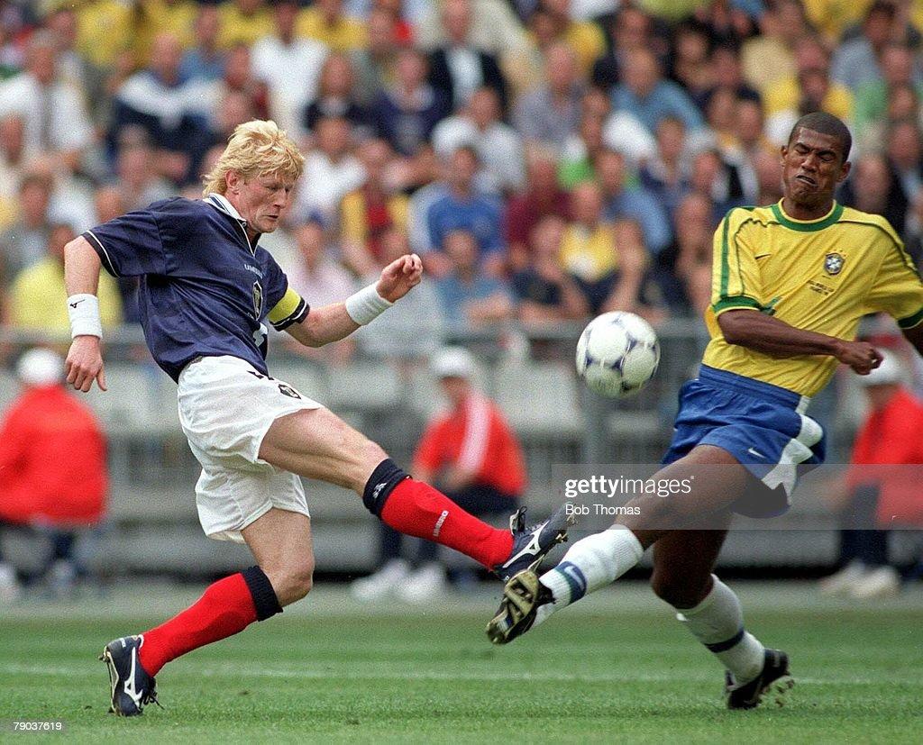 World Cup Finals St Denis Paris 10th June Brazil 2 v Scotland 1 Scotland's Colin Hendry with Brazil's Junior Baiano