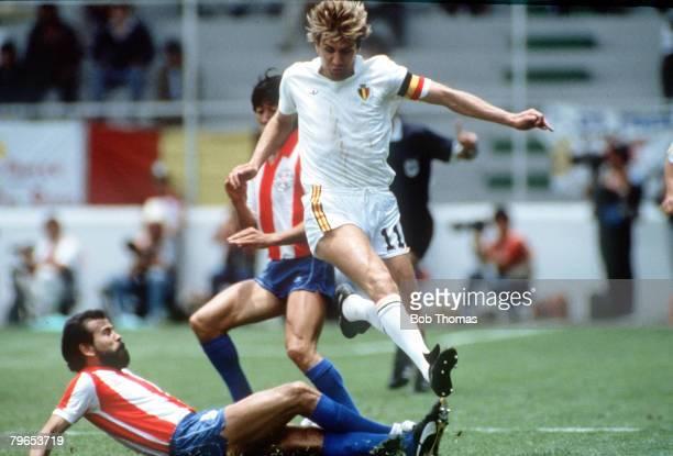 World Cup Finals Toluca Mexico 11th June Belgium 2 v Paraguay 2 Belgium's Jan Ceulemans leaps over the challenge of Paraguay's Rogelio Delgado