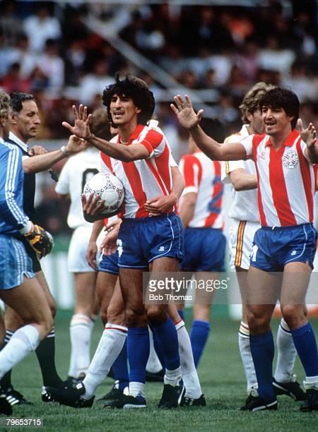 World Cup Finals Toluca Mexico 11th June Belgium 2 v Paraguay 2 Paraguay's Cesar Zabala and Alfredo Mendoza confront Belgia goalkeeper Jean Marie...