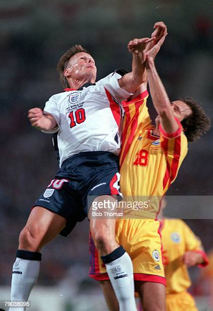 World Cup Finals Toulouse France 22nd June England 1 v Romania 2 England's Teddy Sheringham jumps with Romania's Iulian Filipescu