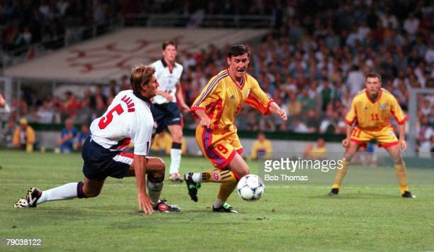 World Cup Finals Toulouse France 22nd June England 1 v Romania 2 Romania's Viorel Moldovan beats Tony Adams to score the first goal