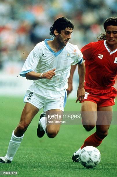World Cup Finals Udine Italy 21st June Uruguay 1 v South Korea 0 Uruguay's Enzo Francescoli is challenged for the ball with South Korea's Joo Sung Kim