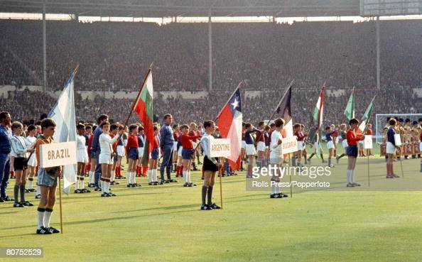 World Cup Finals Wembley England 11th July Opening Ceremony London schoolboys parade in the Stadium wearing the colours and bearing the flags of the...