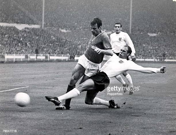 World Cup Finals Wembley Stadium England 20th July England 2 v France 0 England's Ray Wilson slides in to challenge France's Phillipe Gondet for the...