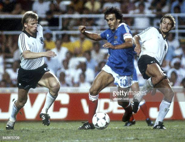 1982 FIFA World Cup in Spain Semifinal in Sevilla Germany 8 7 France Scene of the match Bernd Foerster Michel Platini and Wolfgang Dremmler in action