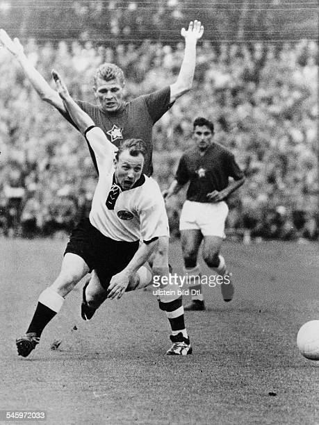 1958 FIFA World Cup in Sweden First round Group 1 in Helsingborg Germany 2 2 CSSR Tackle between Uwe Seeler and Popluhar