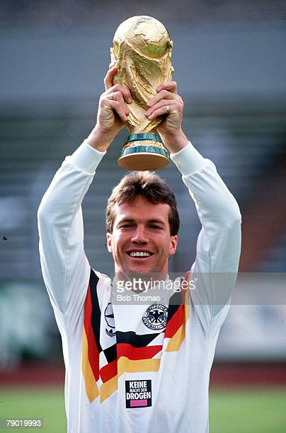 World Cup Italy West German captain Lothar Matthaus holds aloft the trophy at a photocall following their victory over Argentina in Rome