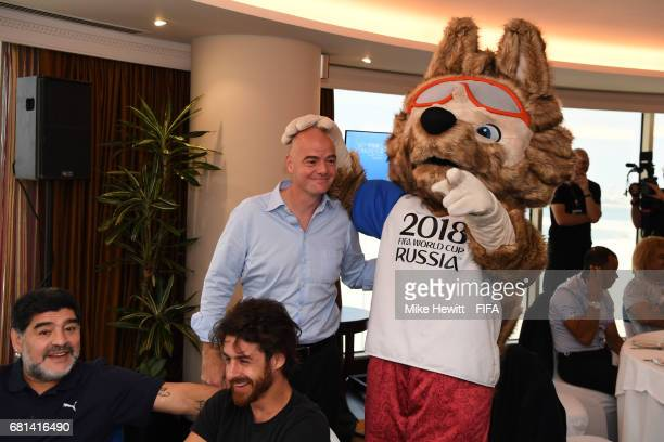 World Cup mascot Zabivaka meets FIFA President Gianni Infantino as FIFA Legends Diego Maradona and Pablo Aimar look on during a FIFA Legends...