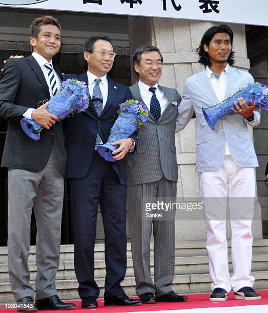 World Cup members Junichi Inamoto head coach Takeshi Okada Kanagawa Prefecture governor Shigefumi Matsuzawa and Yuji Nakazawa pose for photographs...