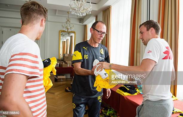World Cup players Erik Durm and Kevin Grosskreutz with kit manager Frank Graefen of Borussia Dortmund on August 4 2014 in Bad Ragaz Switzerland
