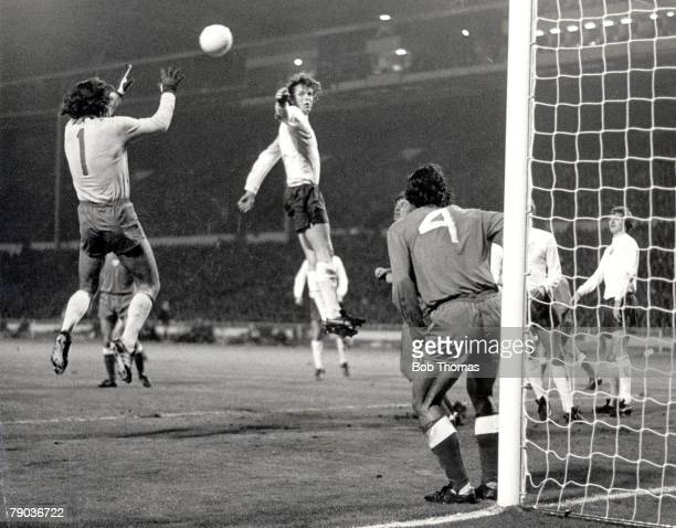 World Cup Qualifier Wembley Stadium 17th October England 1 v Poland 1 England striker Mick Channon jumps but is beaten to the high ball by Polish...