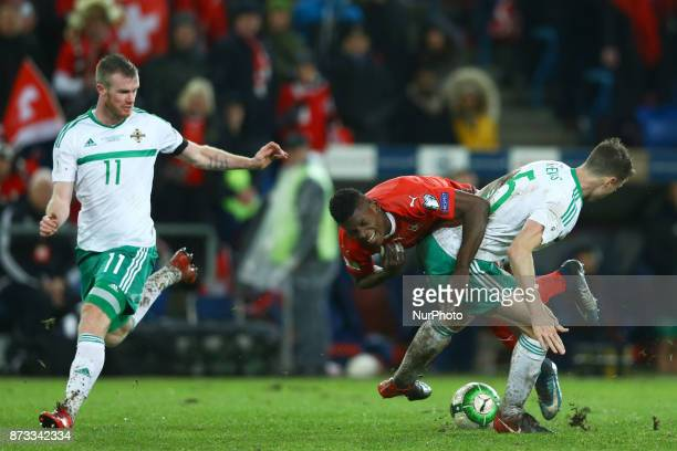 World Cup Qualifiers playoff Switzerland v Northern Ireland A foul by Jonny Evans of Northern Ireland on Breel Embolo of Switzerland at St JakobPark...