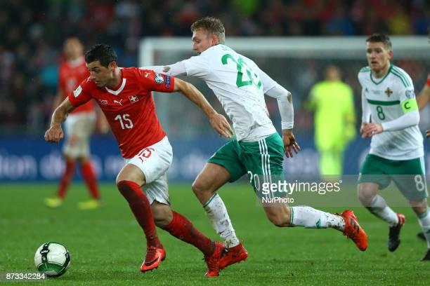 World Cup Qualifiers playoff Switzerland v Northern Ireland Blerim Dzemaili of Switzerland and George Saville of Northern Ireland at St JakobPark in...