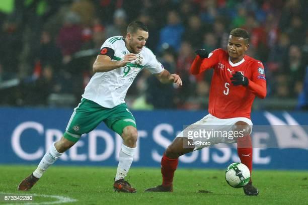 World Cup Qualifiers playoff Switzerland v Northern Ireland Conor Washington of Northern Ireland and Manuel Akanji of Switzerland at St JakobPark in...