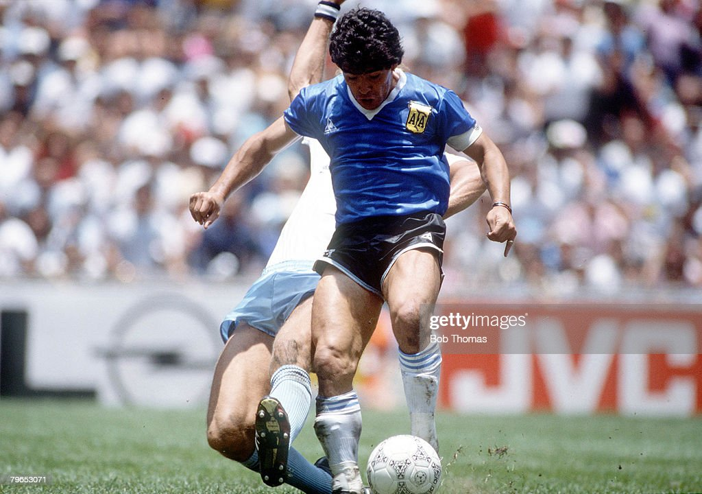 World Cup Quarter Final, Azteca Stadium, Mexico, 22nd June, 1986, Argentina 2 v England 1, Argentina's Diego Maradona beats a tackle from an English defender on his way to scoring his outstanding individual second goal