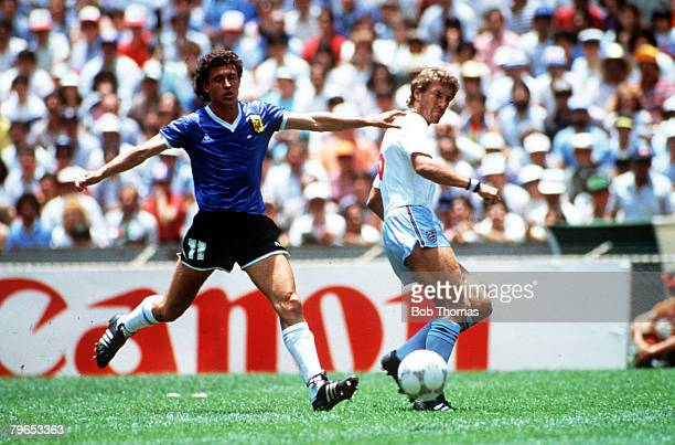 World Cup Quarter Final Azteca Stadium Mexico 22nd June Argentina 2 v England 1 England's Terry Butcher watches the ball with Argentina's Jorge...