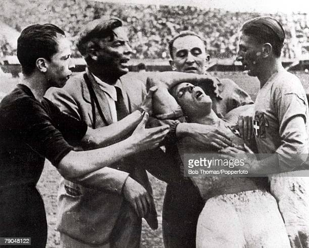 World Cup QuarterFinal Florence Italy 31st May Italy 1 v Spain 1 Italy's Giuseppe Meazza is helped from the field by teammates after being injured