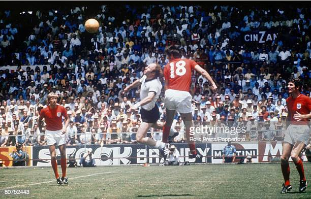 World Cup QuarterFinal Leon Mexico England 2 v West Germany 3 14th June West Germany's Uwe Seeler jumps for the ball with England's Norman Hunter